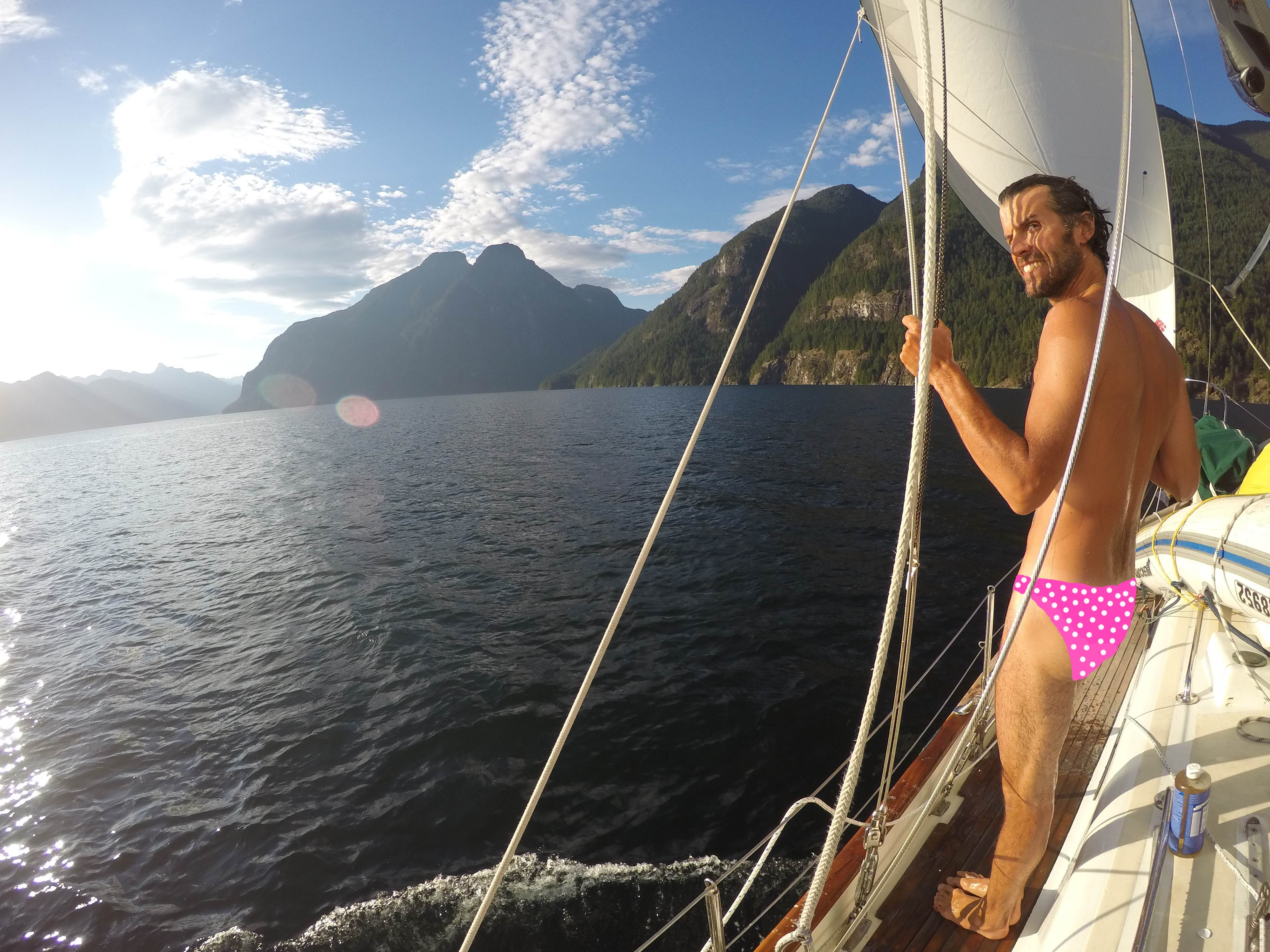 Saxony drew on the pink bikini bottom with white pol-a-dots. Isn't she nice? Seriously though, nicest outdoor shower location of my life. Under sail in Jervis Inlet