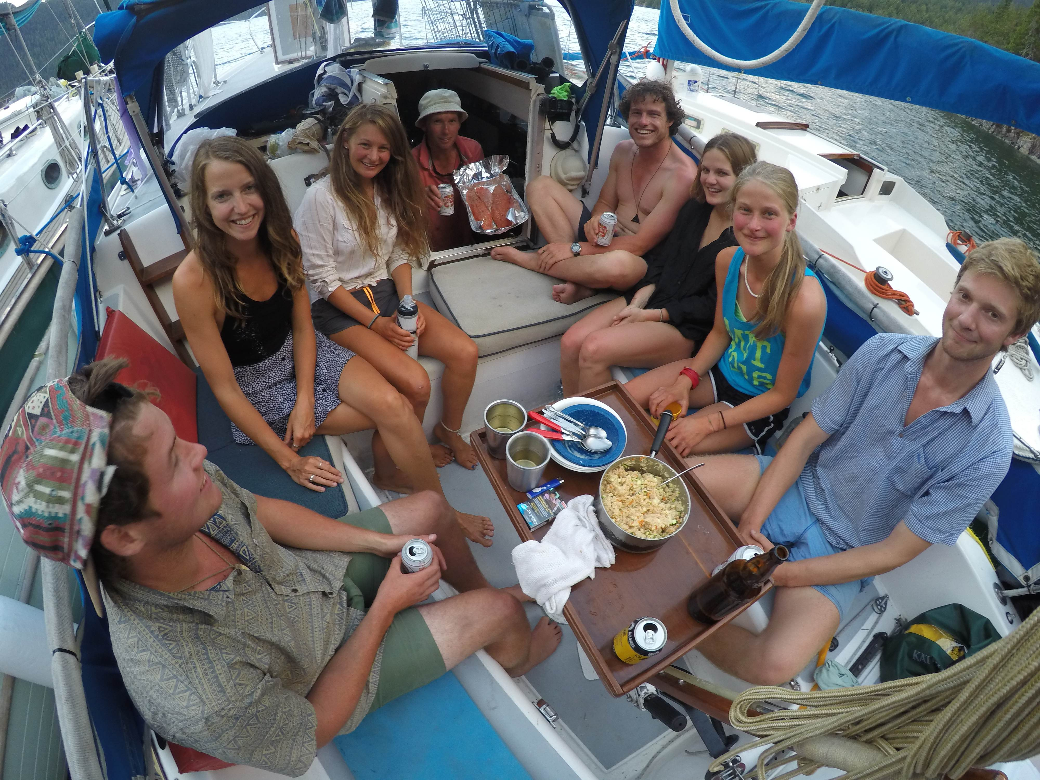 Dinner potluck aboard The Goose. Note tasty salmon fillets that Admiral is holding in companionway