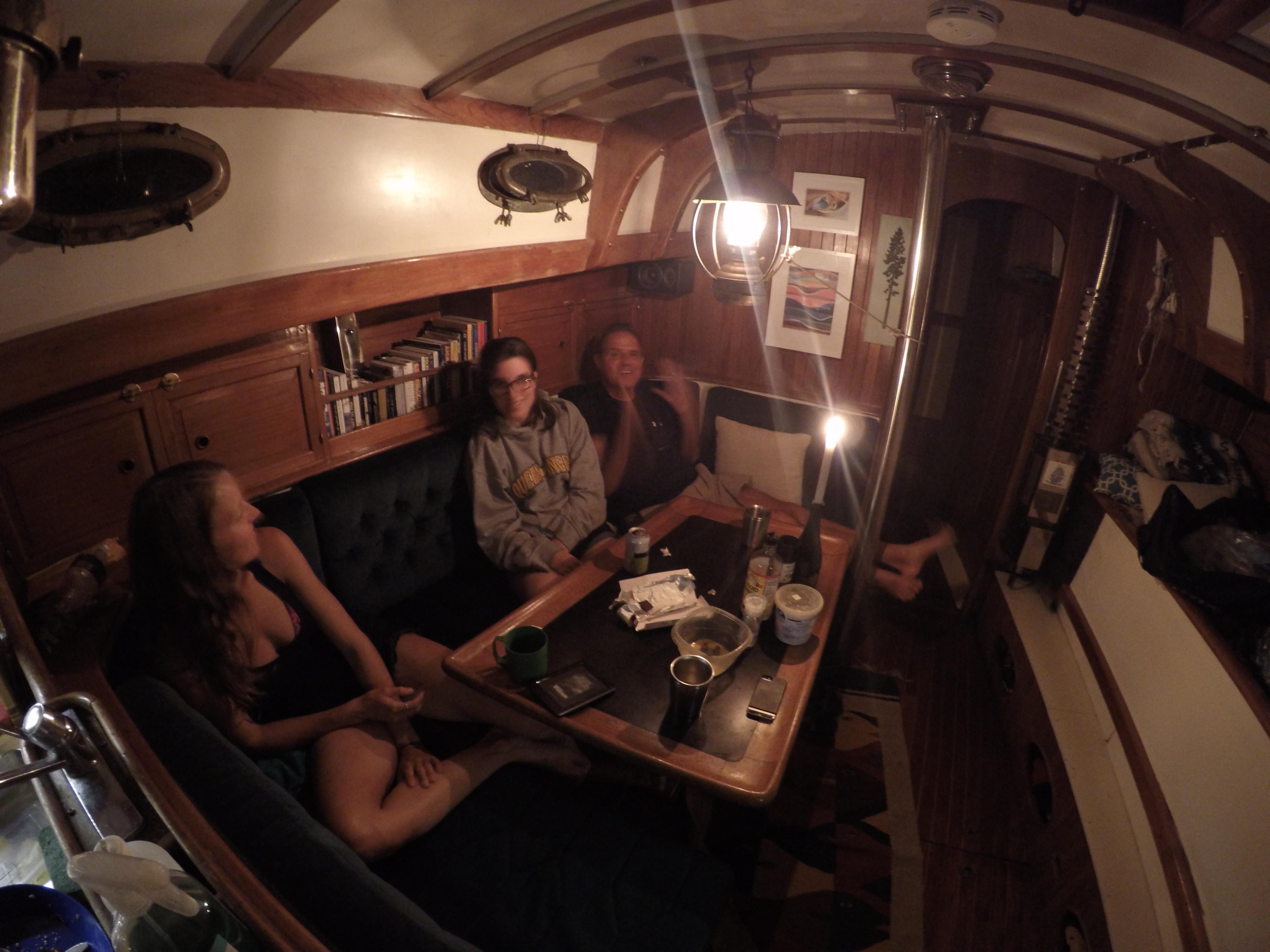 Saxony, Tamara and Roger aboard Leela at night