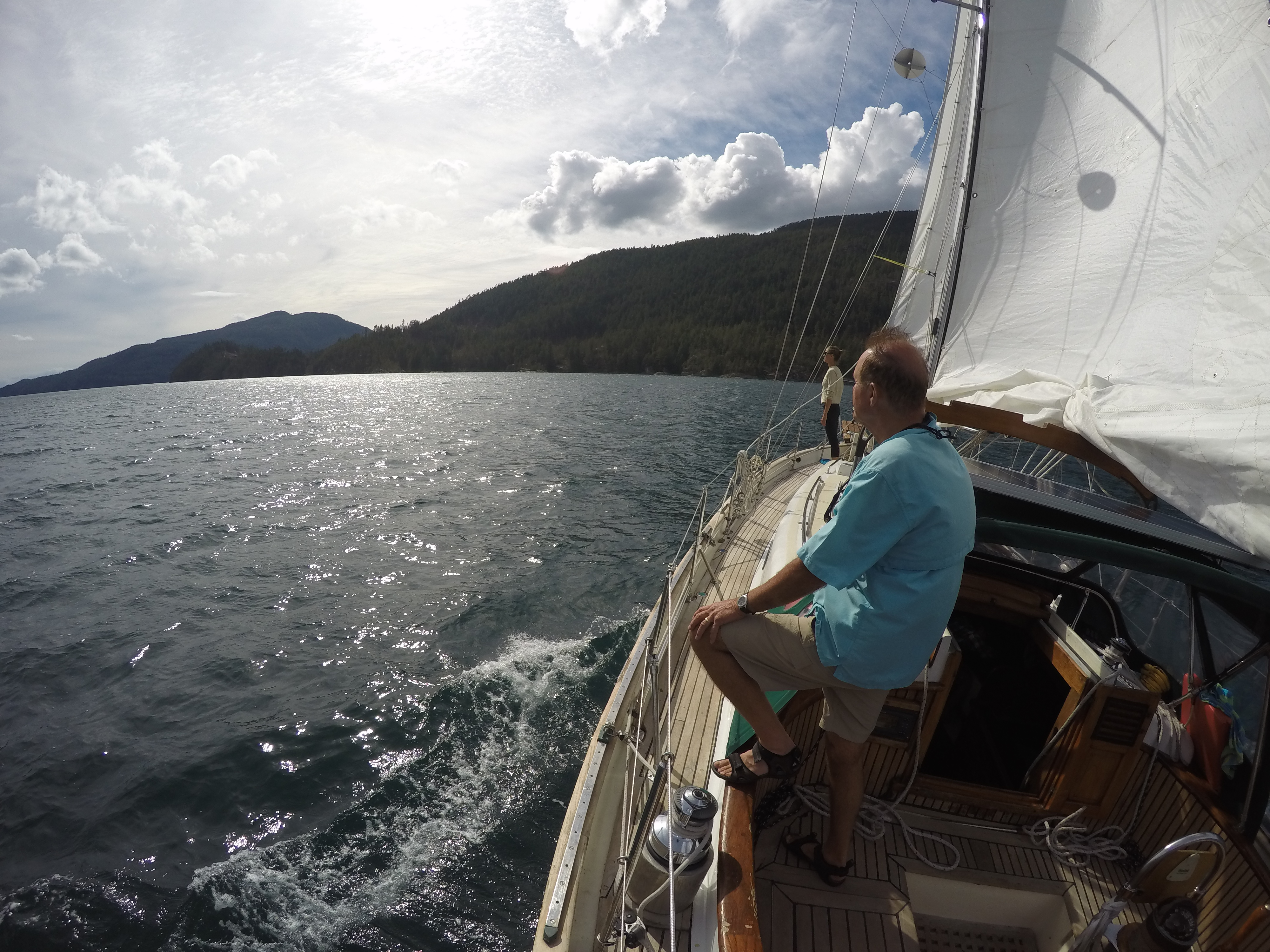 Dad and Saxony sailing Leela in Pendrell Sound