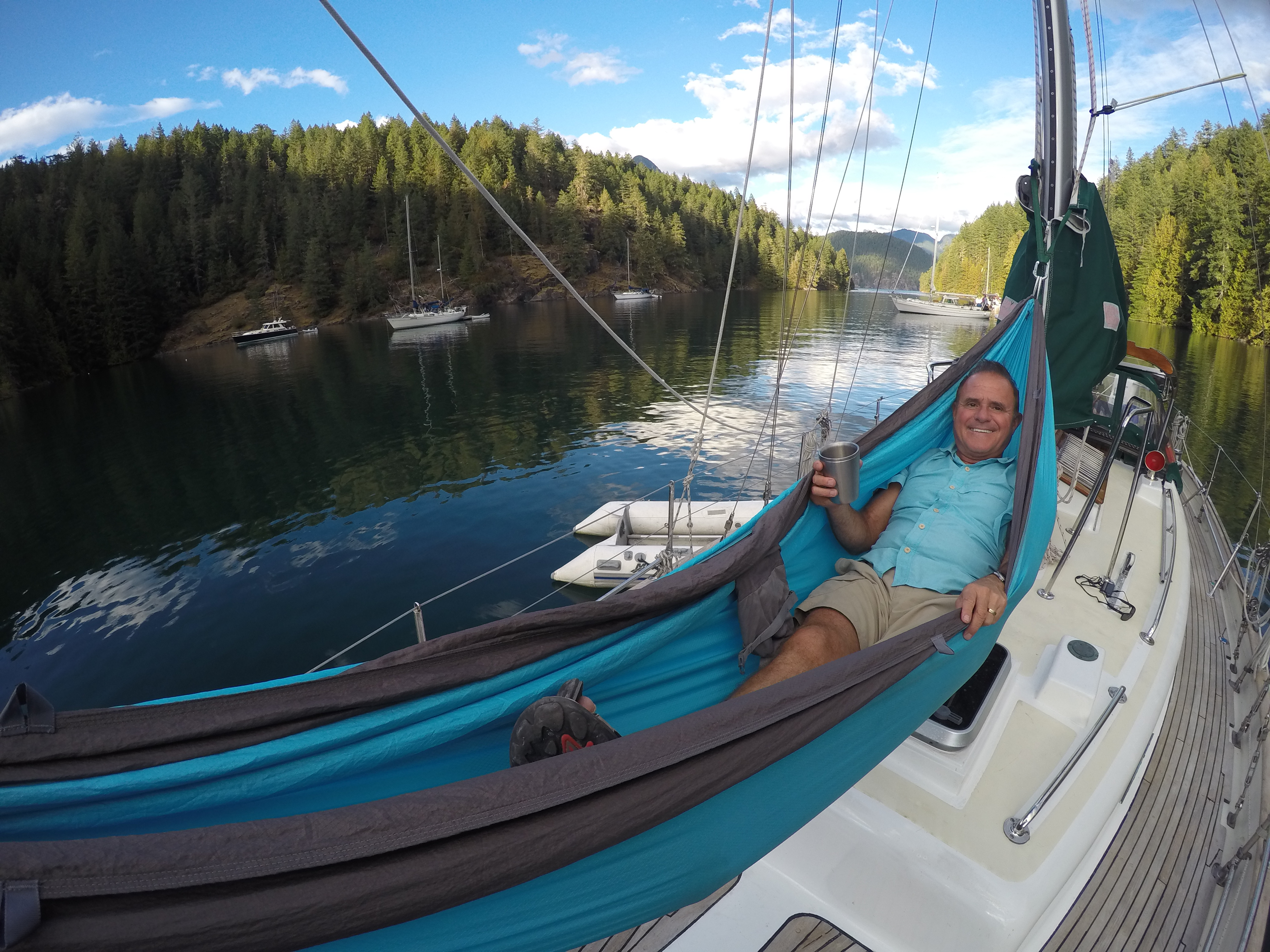Dad in hammock on Leela sailboat in Desolation Sound