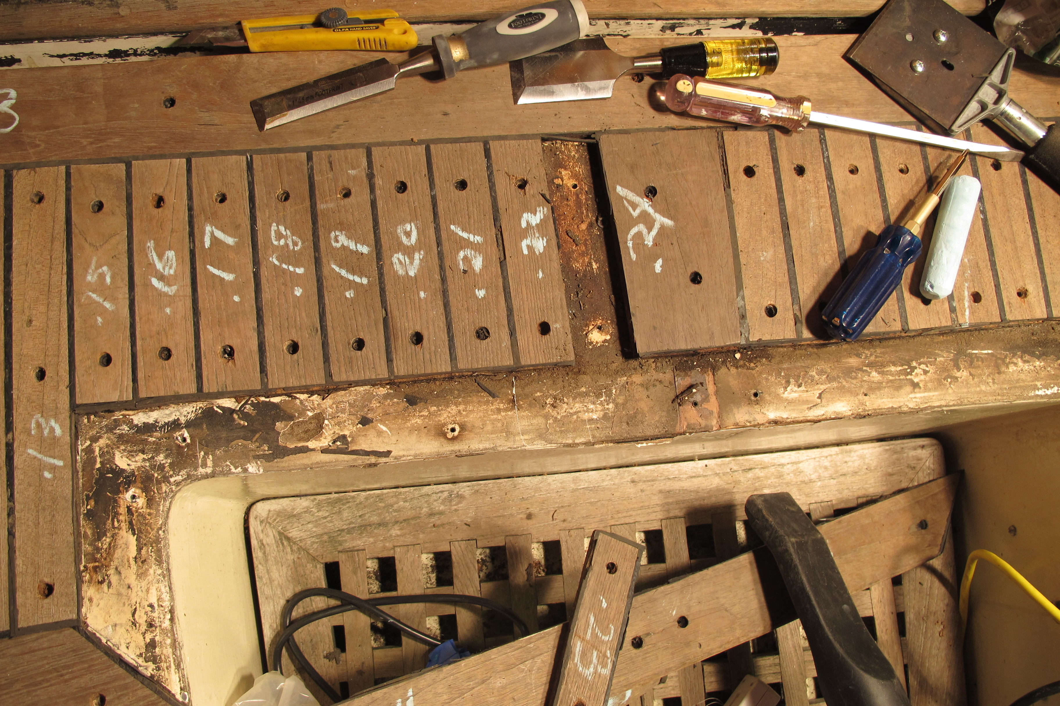 Screws removed, teak planks being carefully removed. Note numbering scheme to help with re-assembly
